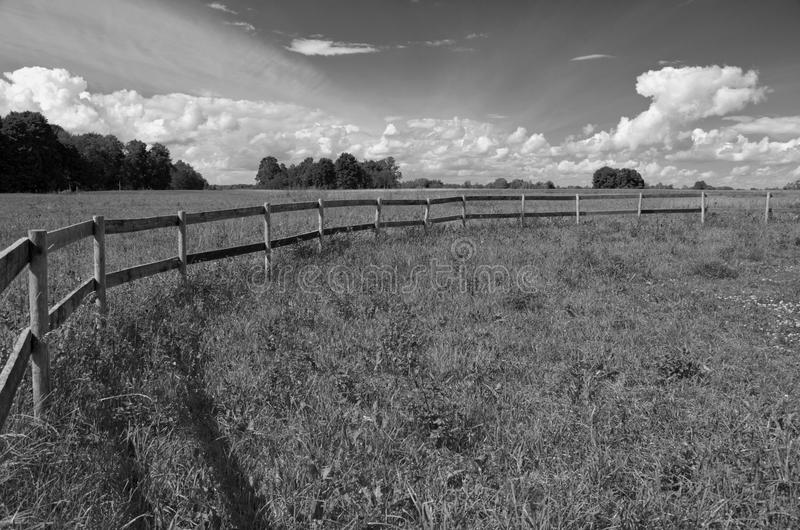 Old Wooden Fence On Nice Green Summer Pasture Meadow Stock