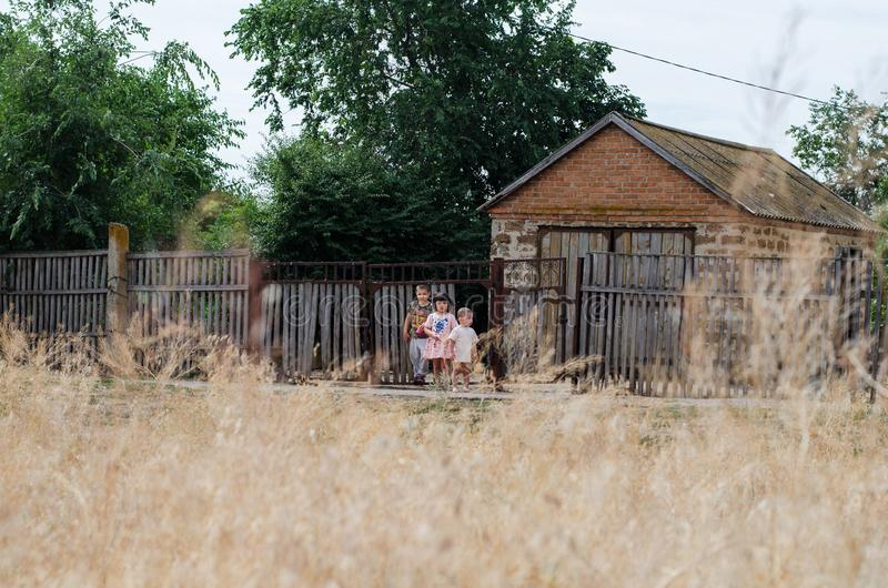 Rural landscape with a house and small children royalty free stock photo