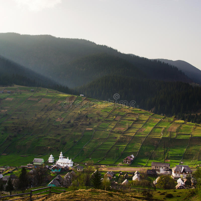 Rural landscape with houses and mountains. House. Rural landscape with village houses and mountains. Spring of Carpatian. Panorama stock photo