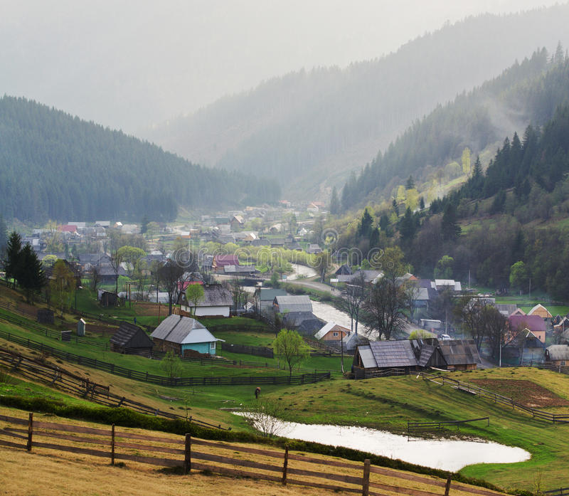 Rural landscape with houses and mountains. Rural landscape with village houses and mountains. Spring of Carpatian. Panorama royalty free stock photography