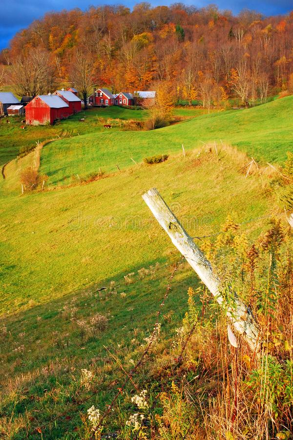 Rural landscape in late fall. A Vermont farm stands in a knoll on a sunny day in late fall royalty free stock photos