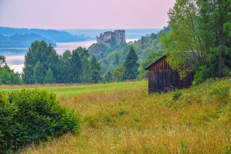 Rural landscape in Pieniny Mountains. Czorsztyn Castle in background. Southern Poland. Rural landscape in Pieniny Mountains. Czorsztyn Castle and Czorsztynskie stock photos