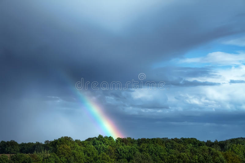 Rural landscape with rainbow stock photos