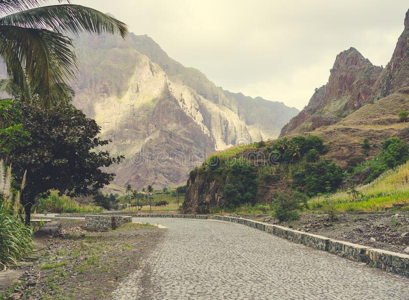 Rural landscape with road surrounded by arid mountains in the Coculi Valley on the island of Santo Antao in Cape Verde.  royalty free stock image