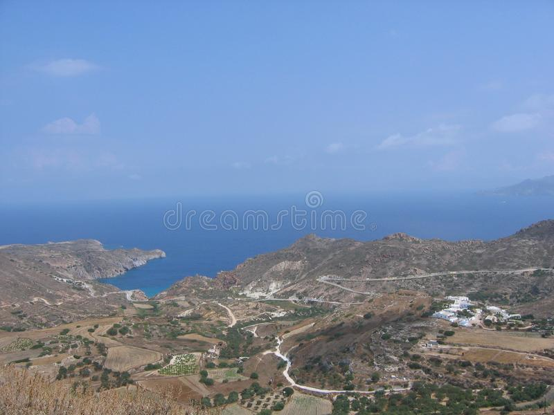 Rural landscape with sight on the sea seen by the tall one in the island of Milos in Greece stock images