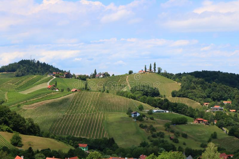 Rural landscape in Styria, Austria, wine route. Dispersed settlement and hills, vineyards and wood. Interesting landscape in Styria, Austria, well known for wine royalty free stock photography