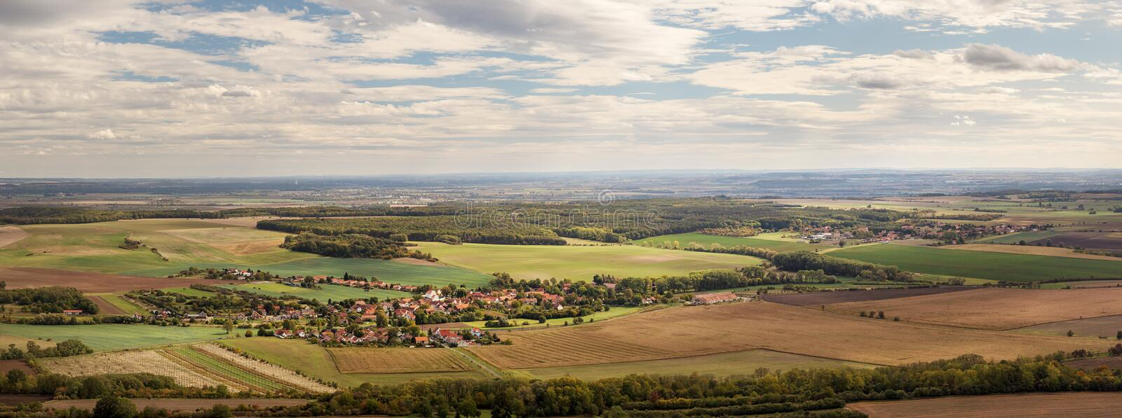 Rural landscape with village Ctineves and fields stock image