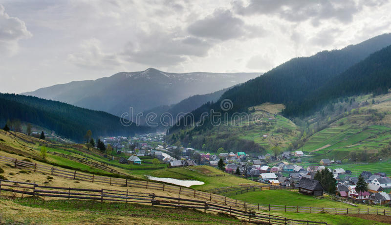 Rural landscape with village houses and mountains. Spring of Carpatian. Panorama royalty free stock images