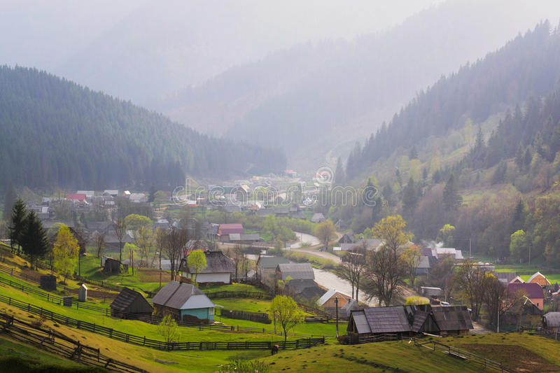 Rural landscape with village houses and mountains. Spring of Carpatian. Panorama stock images