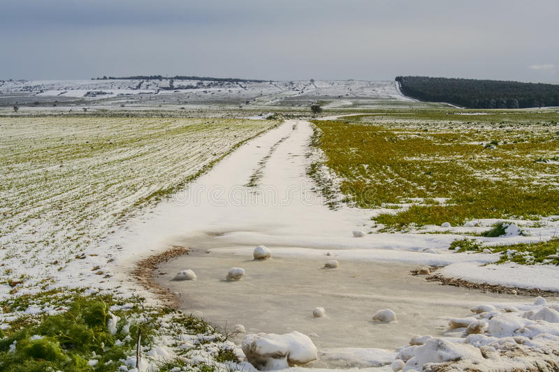 RURAL LANDSCAPE WINTER. Alta Murgia National Park: snowy hills.-Apulia ITALY-. Rural hill with snowy country road.Alta Murgia National Park is a limestone stock photos