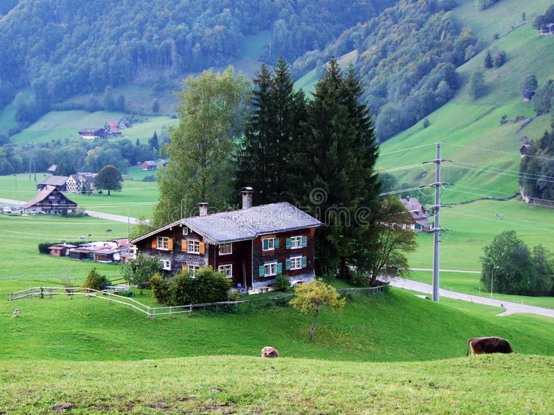 Rural and mountain farms and the traditional architecture in Thur River Valley. Canton St. Gallen, Switzerland royalty free stock images