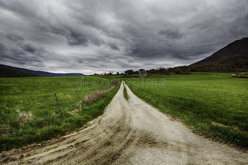 Rural mud road on the mountain stock image