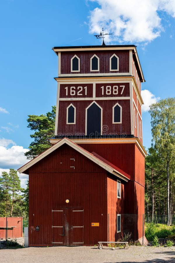 Rural outdoor front view of a historic and famous red wooden shaft building at Sala silver mine in Sweden. SALA, SWEDEN - JULY 24, 2019: Rural outdoor front royalty free stock photo
