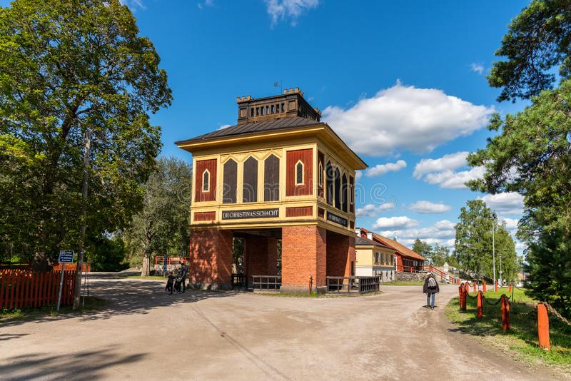 Rural outdoor view of the historic and famous Queen Christinas shaft building at Sala silver mine in Sweden. SALA, SWEDEN - JULY 24, 2019: Rural outdoor view of stock photo