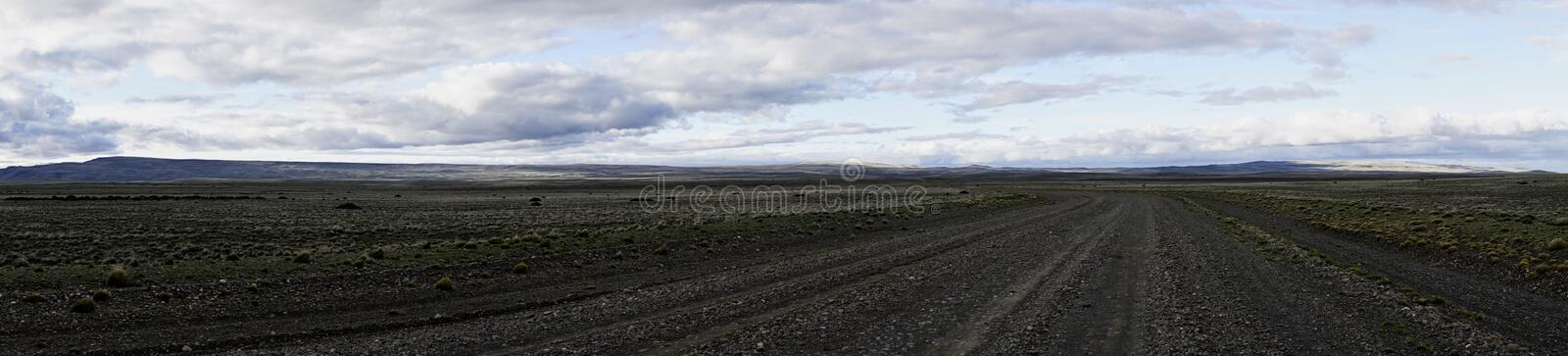 Road in Argentinian Patagonia and Horizon Line. Rural road in Argentinian Patagonia. Panorama. Horizon line royalty free stock photography