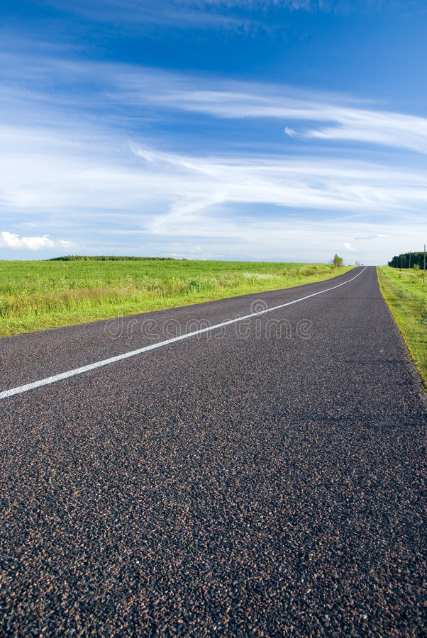 Download Rural road and cloudy sky stock image. Image of green - 6747097