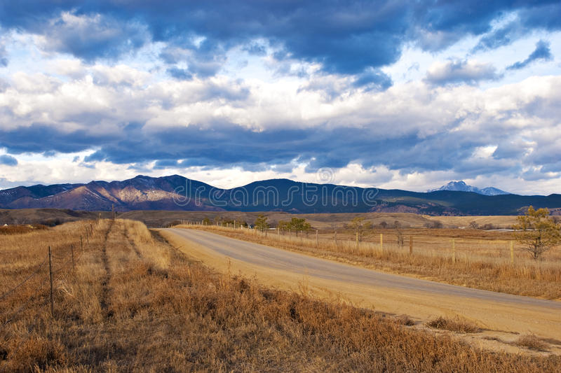 Download Rural Road Leads Towards A Distant Patch Of Light Royalty Free Stock Images - Image: 11834149