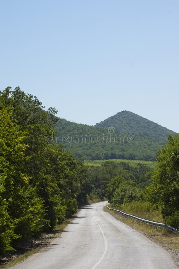 Rural road in the mountains stock photography
