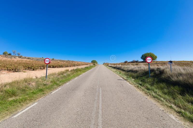 Rural road with two no overtaking signals. In a landscape in Castile, Spain, Europe stock images