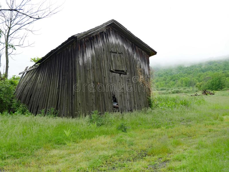 Barn that is falling down royalty free stock photography