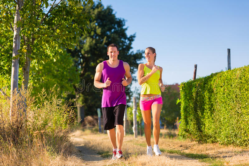Man And Woman Running For Sport Stock Photos