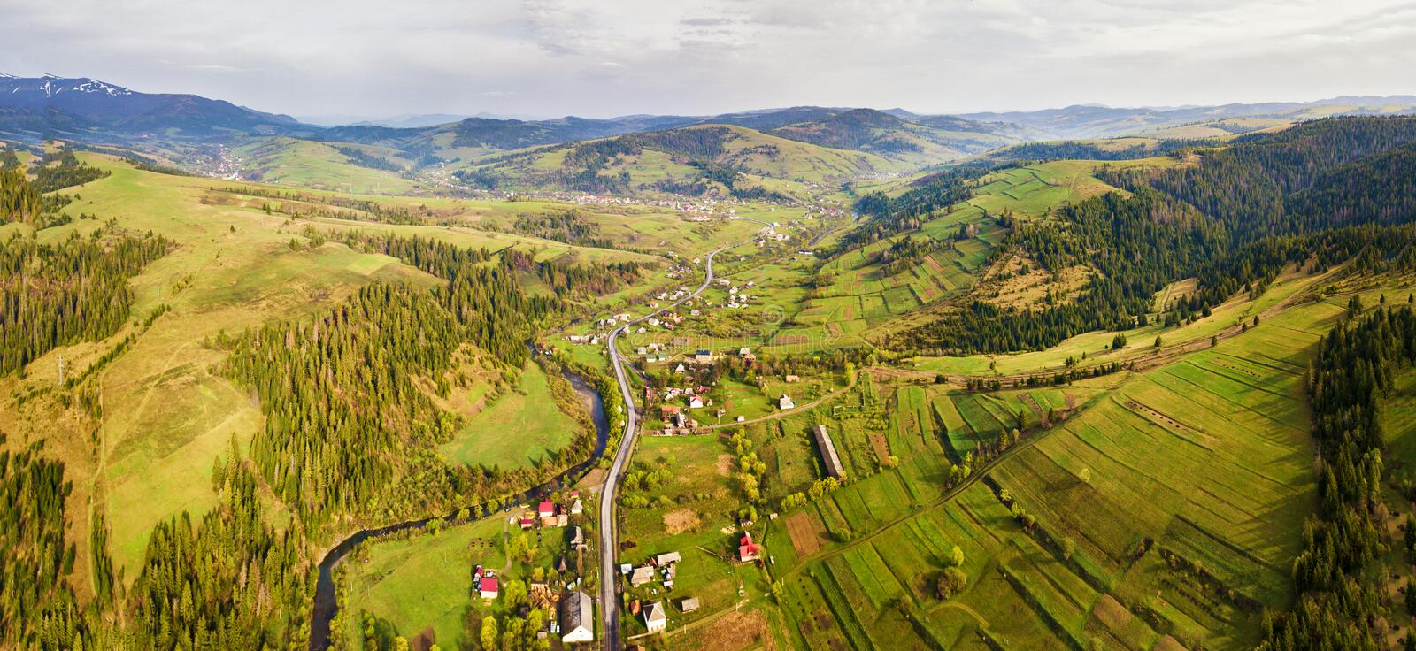 Rural spring misty landscape. Aerial Panorama of Carpathian valley royalty free stock photography