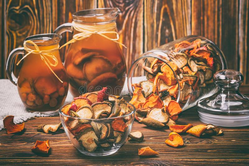 Rural still-life - compote with dried fruits from apples and pears close-up stock photos