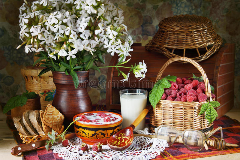 Rural still life with raspberries and milk royalty free stock photos