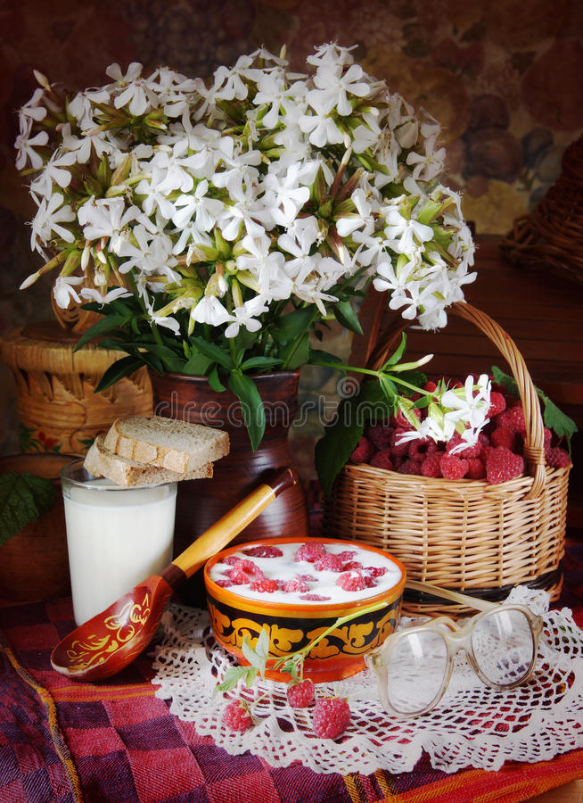 Rural still life with ripe raspberries and milk royalty free stock photography