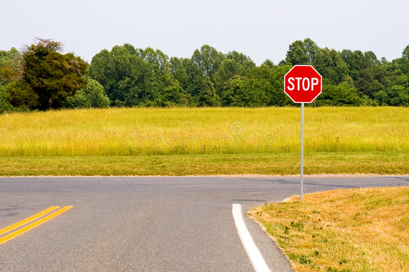Rural stop sign intersection stock photo