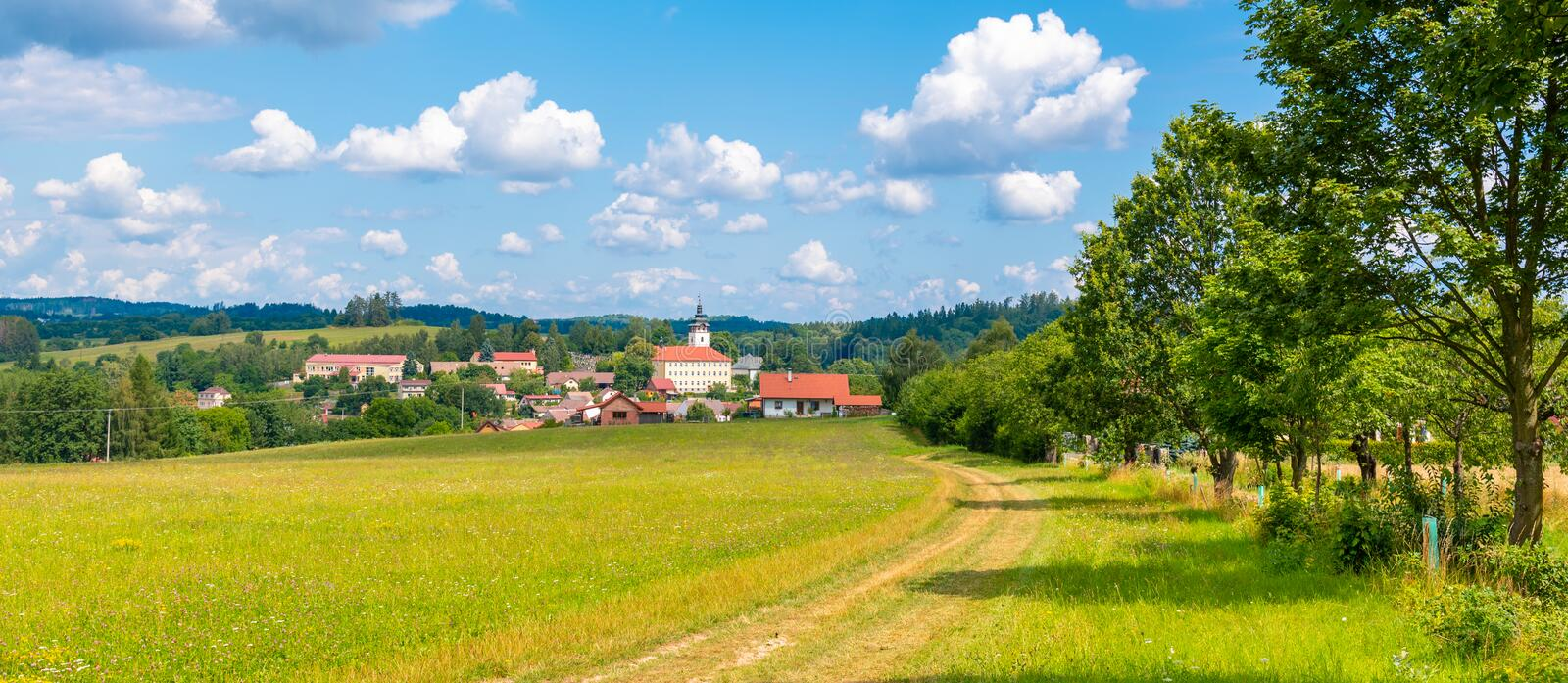 Rural summer landscape with green meadow, blue sky and white clouds. Jistebnice, South Bohemia, Czech Republic royalty free stock images