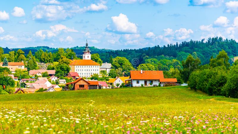 Rural summer landscape with green meadow, blue sky and white clouds. Jistebnice, South Bohemia, Czech Republic.  royalty free stock photos