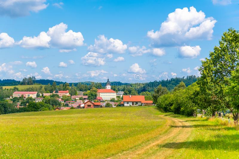 Rural summer landscape with green meadow, blue sky and white clouds. Jistebnice, South Bohemia, Czech Republic.  royalty free stock photography
