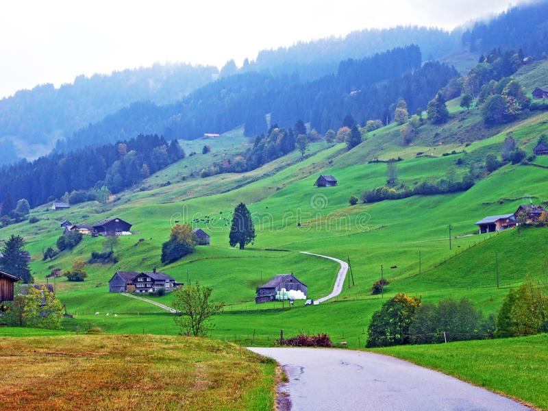Rural traditional architecture and livestock farms in the Obertoggenburg region, Stein. Canton of St. Gallen, Switzerland stock photos