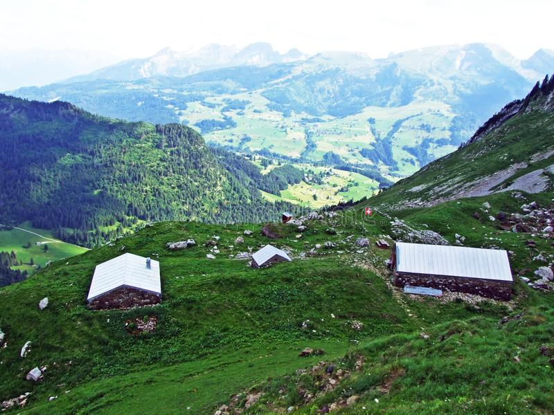 Rural traditional architecture and livestock farms on the slopes of Alpstein mountain range and in the river Thur valley. Canton of St. Gallen, Switzerland stock photos