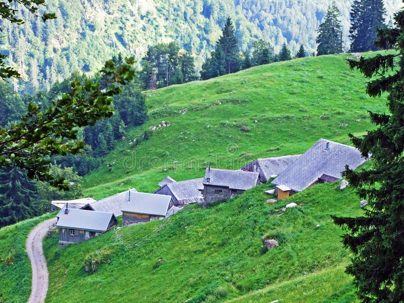 Rural traditional architecture and livestock farms on the slopes of Alpstein mountain range and in the river Thur valley. Canton of St. Gallen, Switzerland royalty free stock photos