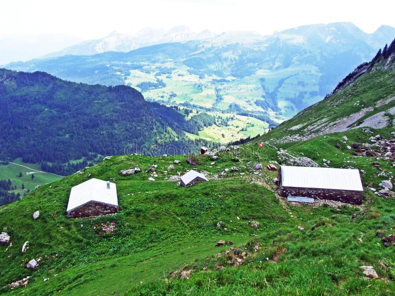 Rural traditional architecture and livestock farms on the slopes of Alpstein mountain range and in the river Thur valley. Canton of St. Gallen, Switzerland stock photo