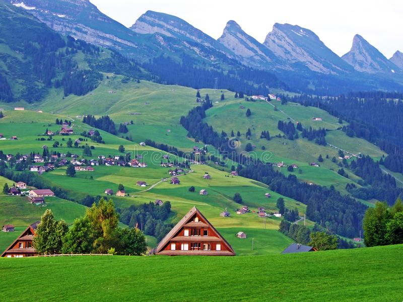 Rural traditional architecture and livestock farms on the slopes of Alpstein mountain range and in the river Thur valley. Canton of St. Gallen, Switzerland stock images