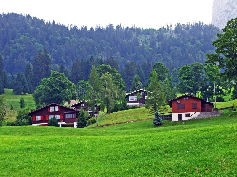 Rural traditional architecture and livestock farms on the slopes of Alpstein mountain range and in the river Thur valley. Canton of St. Gallen, Switzerland royalty free stock image