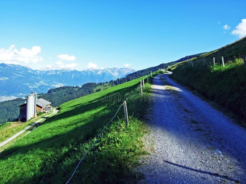 Rural traditional architecture and livestock farms on the slopes of Alviergruppe and in the Rhine valley. Canton of St. Gallen, Switzerland royalty free stock photography