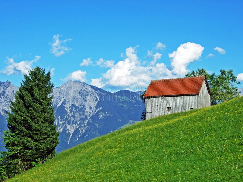 Rural traditional architecture and livestock farms on the slopes of Alviergruppe and in the Rhine valley. Canton of St. Gallen, Switzerland royalty free stock photo