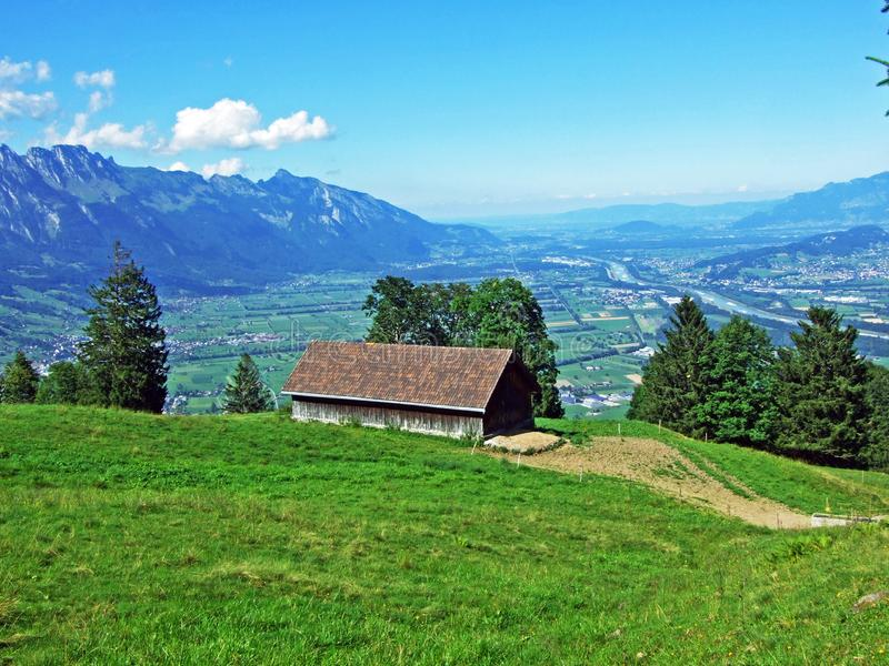 Rural traditional architecture and livestock farms on the slopes of Alviergruppe and in the Rhine valley. Canton of St. Gallen, Switzerland stock photography
