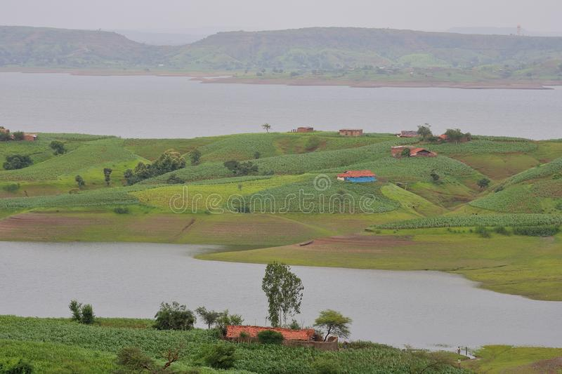 Landscape in nature, mahi back water, banswara, rajasthan, India. Rural village on the island between the water, Green trees, green small hill, water of river royalty free stock photography