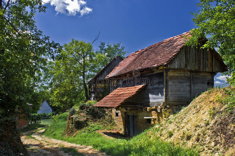 Rural village with wooden cottages royalty free stock images