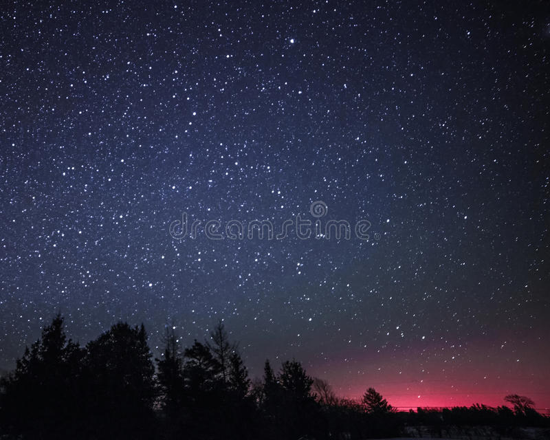 Rural Winter Landscape at night with trees and stars stock images