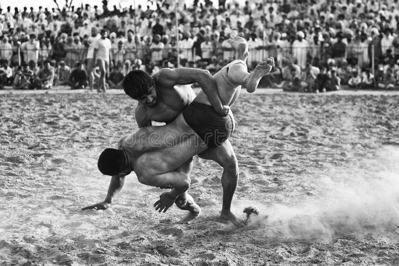 Rural wrestling sports match in punjab india stock images