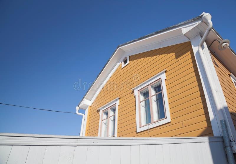 Rural yellow wooden house stock photos