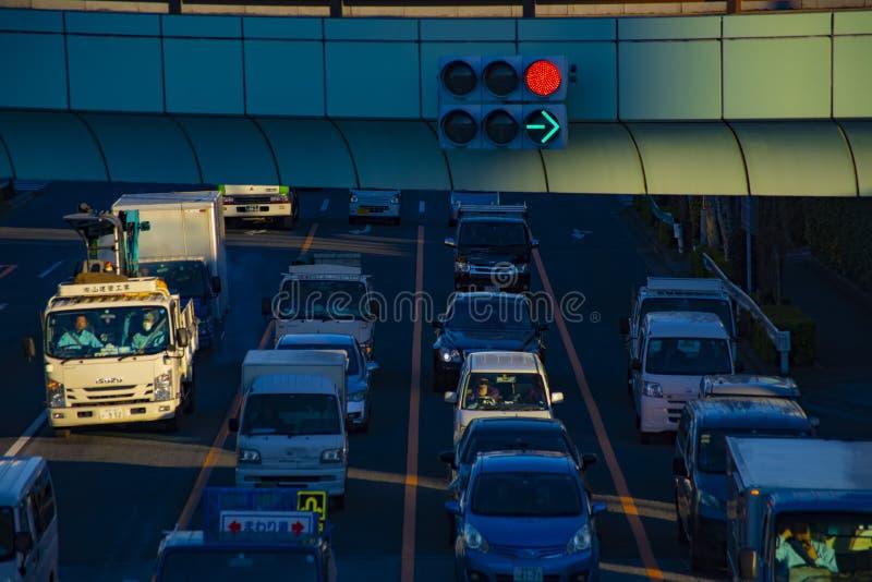 Rusa bilar p? den i stadens centrum korsningen i den Tokyo dagen fotografering för bildbyråer