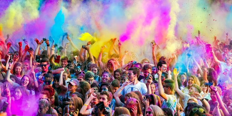 Happy young people dancing and celebrating during Music and Colors festival royalty free stock photo