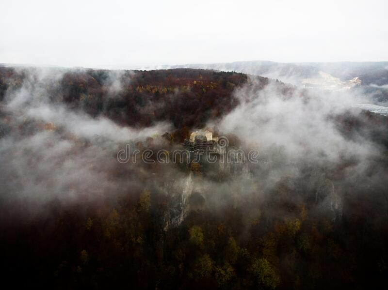 Rusenschloss covered in fog near Blaubeuren in Baden-Wuerttemberg, Germany. Rusenschloss covered in fog near Blaubeuren, Baden-Wuerttemberg, Germany royalty free stock image